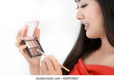 Beauty woman model with cosmetic makeup colorful set