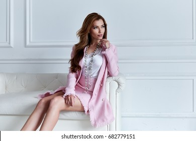 Beauty woman model wear stylish design trend clothing silk pink jacket suit skirt casual formal office style walk party long blond hair party businesswoman secretary diplomatic protocol room sofa.