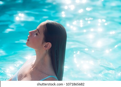 Beauty of woman is moisturized in bath. beauty and youth of pretty woman in swimming pool.