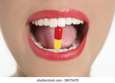 Beauty woman mouth with red lips and medicine pill