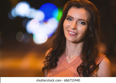 beauty woman in the night city with light bakeh