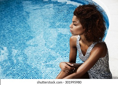 beauty woman in octail dress in pool party