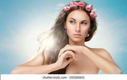 beauty woman on the sky background