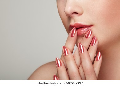Beauty woman with perfect makeup. Glamour girl. Red lips and nails. Skin care foundation. Beauty girls face isolated on light background. Fashion photo