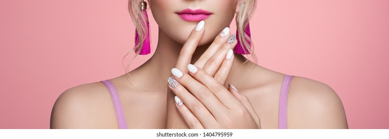Beauty Woman with perfect Makeup and Manicure. Glamour Girl with Jewelry. Pink Lips and Nails. Beauty girls Face isolated on light Background. Fashion photo