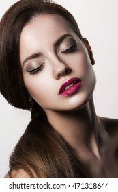 Beauty Woman with Perfect Makeup. Pink Lips. Closeup portrait of young lady