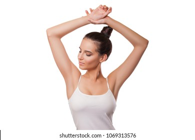 Beauty Woman with perfect skin armpits. Beautiful brunette girl holding her arms up and showing clean underarms. Armpit epilation, lacer hair removal.