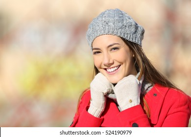 Beauty woman with perfect white smile posing warmly clothed in a sunny day of winter