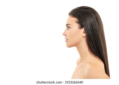 Beauty woman. Portrait of a beautiful brunette girl with light natural makeup on a white background with copy space. Spa, skincare and cosmetics. Body care.
