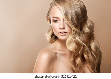Beauty Woman Portrait. Beautiful Spa Girl Perfect Fresh Skin. Youth and Skin Care Concept. Beige background