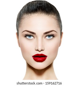 Beauty Woman Portrait. Professional Makeup for Brunette with Blue eyes - Red Lipstick. Beautiful Fashion Model Girl Face. Perfect Skin. Make up. Isolated on a White Background.