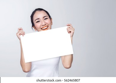 Beauty woman portrait. Skin and face care concept holding white signage with free copyspace for your text on white background