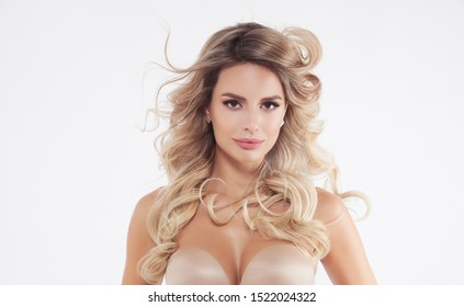 Beauty woman portrait. Skin, hair and face care concept with beautiful serene  woman with make up relaxing isolated on white background. Caucasian / female beauty blonde model relaxed.