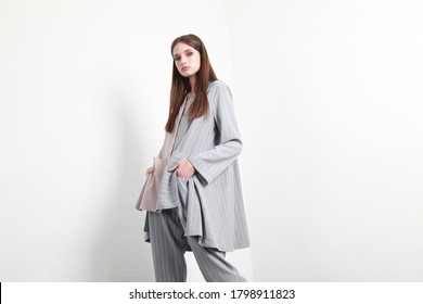 beauty woman pretty face wearing lose summer autumn two piece suit long slim body shape, clothes catalog of spring collection studio brunette curly hair date clothes walk casual fashion.  - Shutterstock ID 1798911823