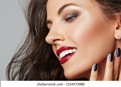 Beauty Woman Profile with clean skin and red lips. Professional Makeup for Brunette. Beautiful Smiling Fashion Model Girl with white teeth. Perfect Skin Contouring Make up.