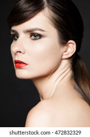 Beauty woman with red lips and smokey eyes on black background. Natural portrait. Healthy leaving. Classic photography