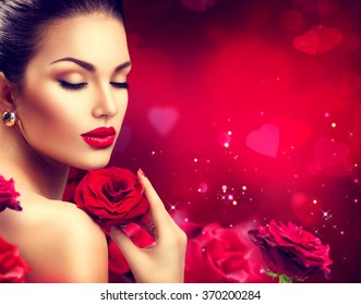 Beauty woman with Red Rose. Valentine. Red Lips and Nails. Beautiful Luxury Makeup and Manicure. Valentine's Day border design. Portrait of fashion model girl over blurred red background