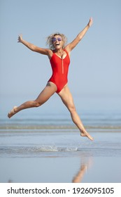 beauty woman in red swimsuit on the beach