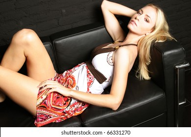 Beauty woman relaxing on a sofa.