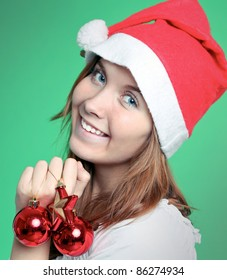 Beauty woman in santa hat with christmas red balls