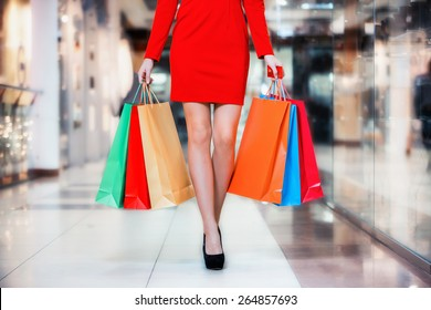 Beauty Woman With Shopping Bags In Shopping Mall. Sale Concept