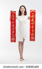 "beauty woman show couplets show ""Every thing will be done as your wish"" with chinese new year"