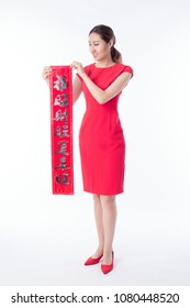 "beauty woman show couplets show ""happy lucky and wealthy "" with chinese new year"