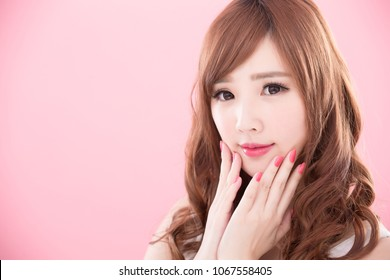 beauty woman show her nails on the pink background