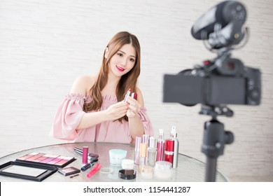 beauty woman show something in live at home