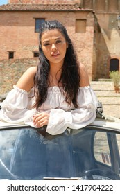 Beauty Woman Sitting Against Retro Car. Old Italy Series.