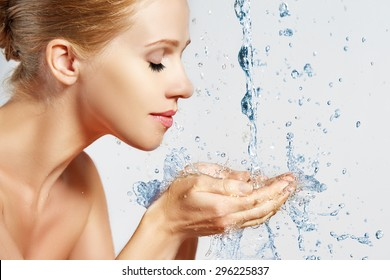 Beauty woman skin care, washing with splashes and drops of water