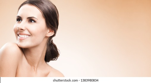 Beauty woman, skin or dental care concept face portrait. Beautiful girl with perfect fresh clean skin. Brunette female model. Copyspace area for some advertising text or slogan. Beige color background