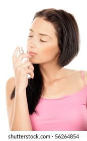 Beauty woman smelling perfume