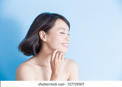 beauty woman smile happily on the blue background