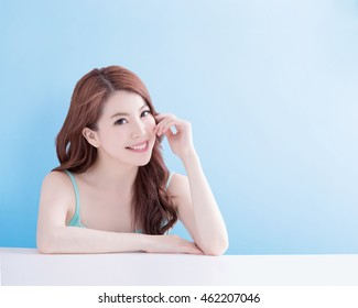 beauty woman smile and look you happily with isolated blue background, asian