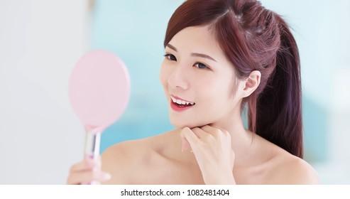 beauty woman take mirror in the bath room