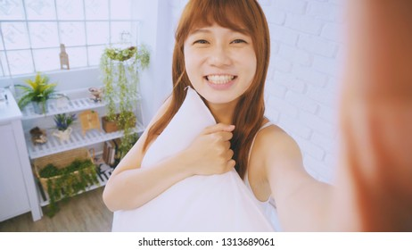 beauty woman take phone selfie on the bed