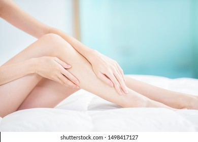 Beauty woman touch her sexy leg at home