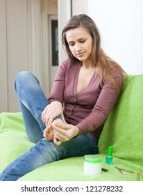 beauty woman treats her toenails
