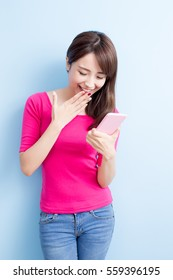 beauty woman use cellphone isolated on blue background