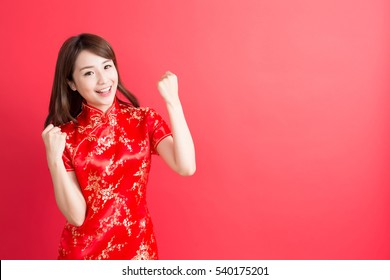 beauty woman wear cheongsam and feel excited with chinese new year