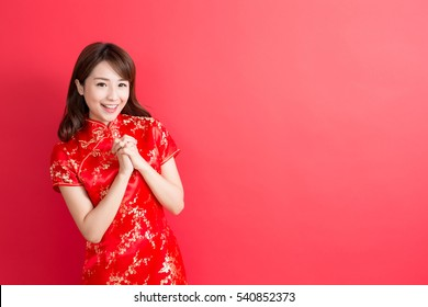 beauty woman wear cheongsam and smile to you in chinese new year