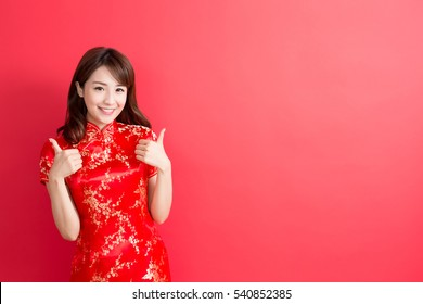 beauty woman wear cheongsam and thumb up with chinese new year