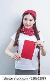 beauty woman wear holiday hat and take Red envelopes chinese new year