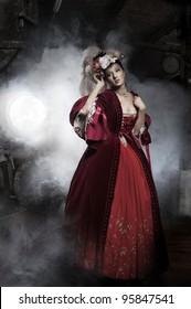 Beauty woman wearing old fashioned dress