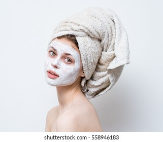Beauty woman in white mask for cleansing the face of acne