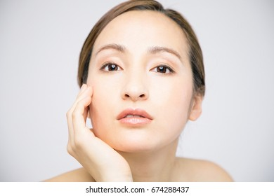beauty woman who checks her skin, skin care, acne treatment