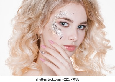 Beauty women portrait of young curly blond woman with pastel manicure and perfect art make-up with glitter. Isolated