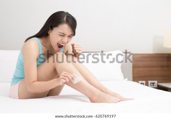 beauty women remove leg hair on the bed