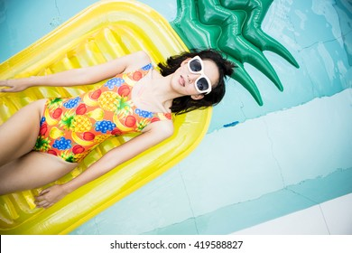 beauty women with sunglasses and pool toy in summer